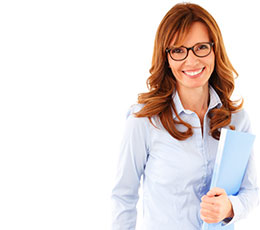 Smiling female college instructor wearing glasses and holding books