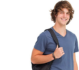 Smiling male student carrying backpack