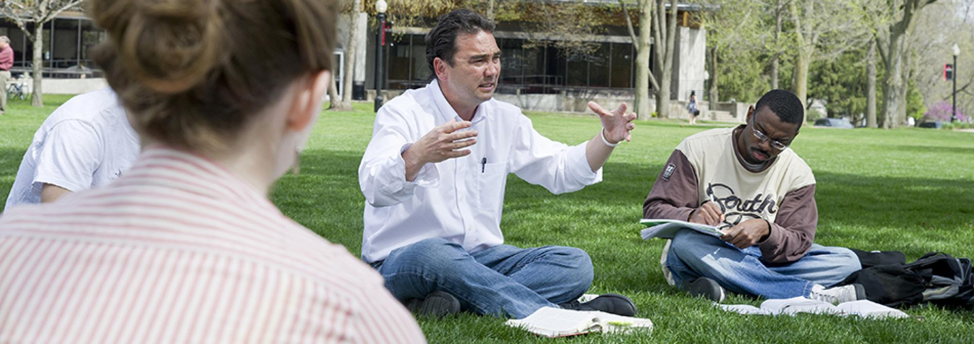 Professor holds class outdoors