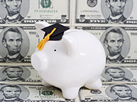 Photo of a piggy bank with graduation cap