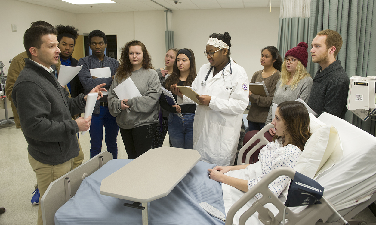 Student actors, health sciences students coming together for clinical simulations