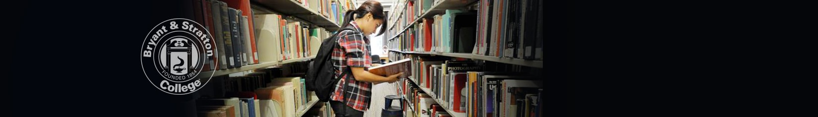 Student in library searching for books