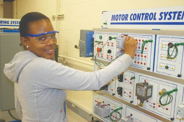 Africa American female wearing goggles in a lab