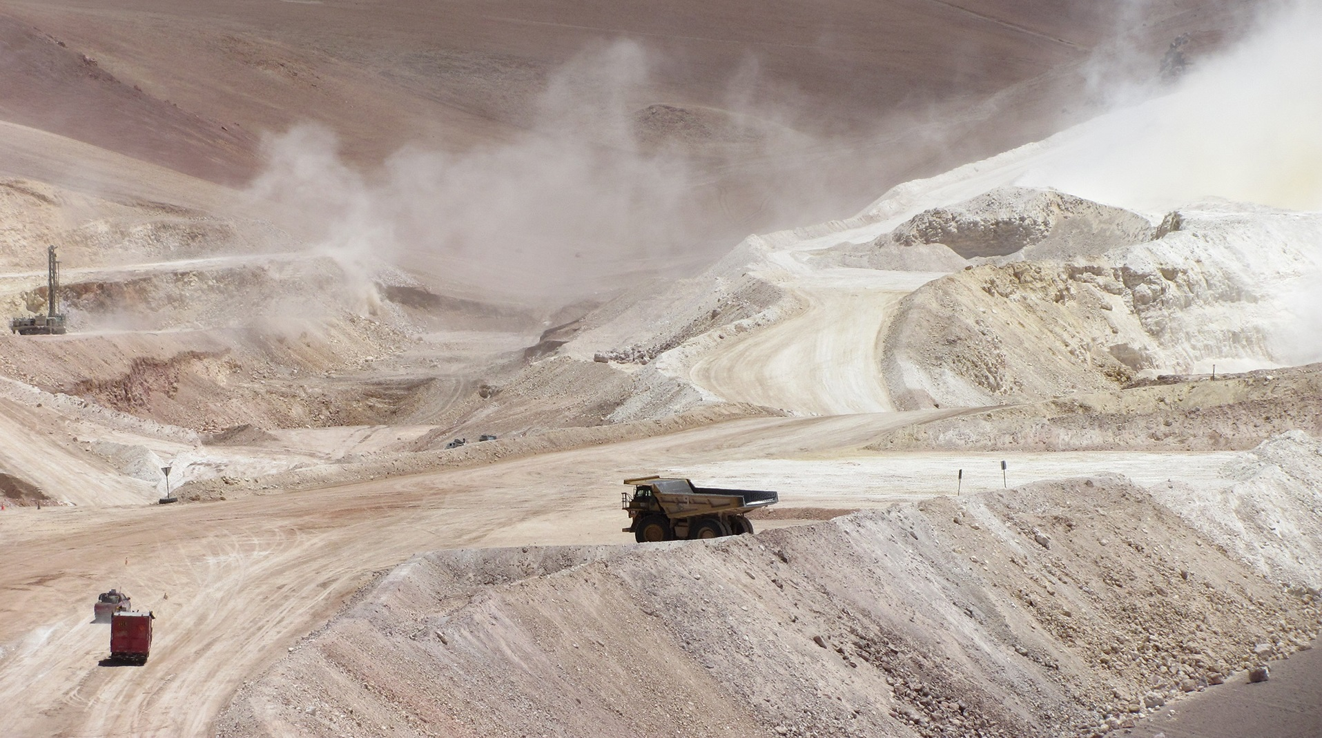 Massive trucks shifting ore at a mine site